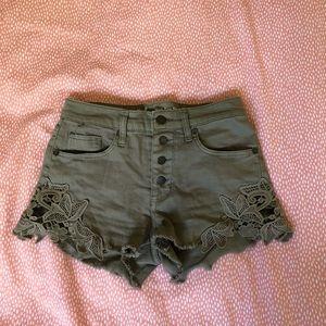 green high rise detailed jean shorts